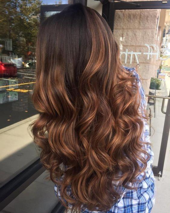 Dark brown hair with deep auburn highlights