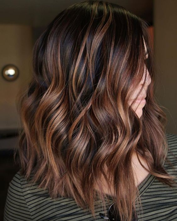 Medium brown hair with copper highlights